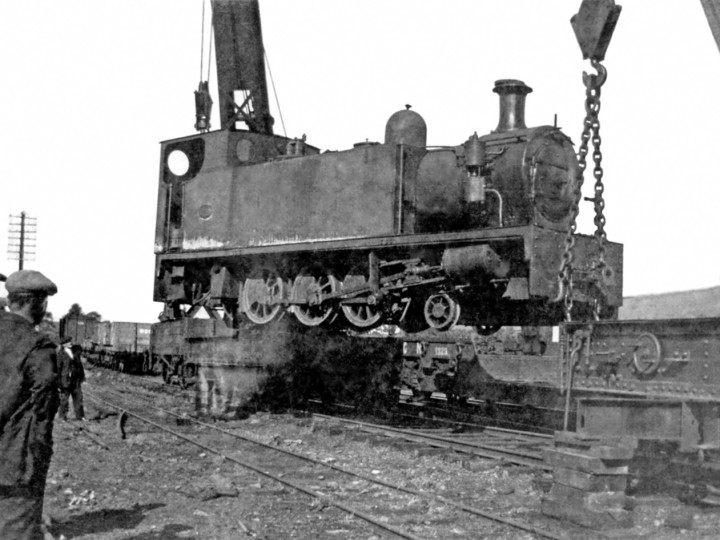 October 1934: Both cranes unload Castlederg No.4 at Maguiresbridge.