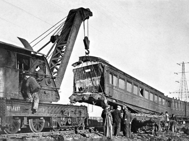 10/1/1945: GNR steam crane 2 lifting the railmotor at Ballymacarrett after crash. W Jones, crane driver, at crane cab.