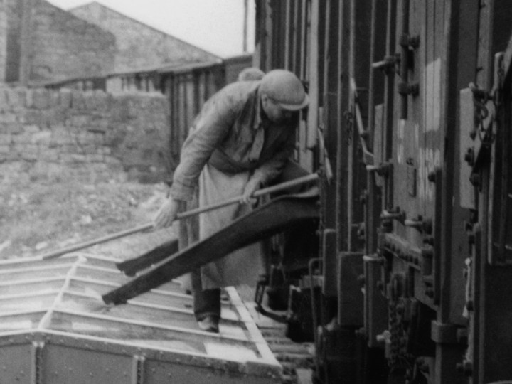 29/4/1961: Unloading chutes in use on one of Scotts grain vans at Omagh General goods yard. (D. Coakham)