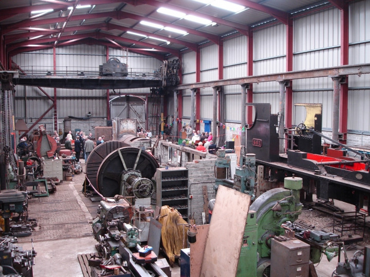 4/7/2006: Official opening day, and a view of the speakers inside the workshop. The large machine in the middle of the workshop is the wheel lathe, whilst the overhead crane is seen visible at the far end.
