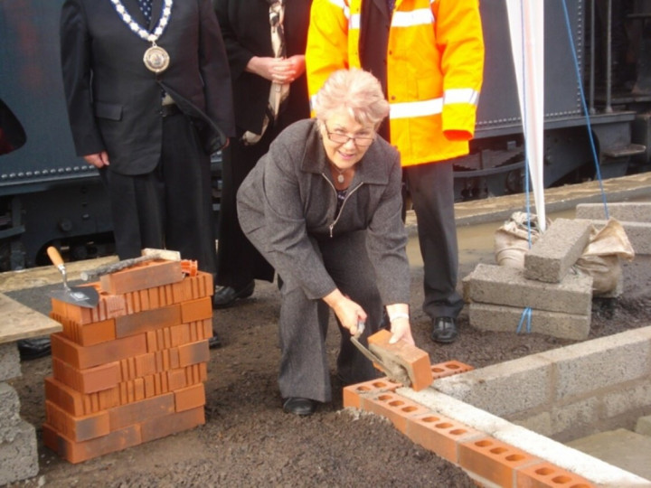 17/10/2017: Invited guests attend a ceremony at Whitehead to mark the official laying of the first brick. The brick was laid by Vera McWilliam of major sponsor GROW. (P. McCann)