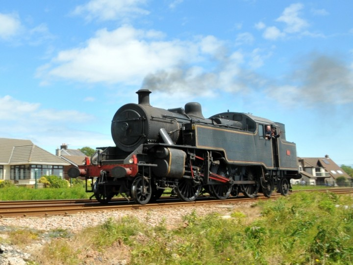 Two views of No.4 at Eden. The first is a light engine trial to Carrickfergus. The second is a test with seven carriages to Belfast Central, 14th June 2015. (C.P.Friel)