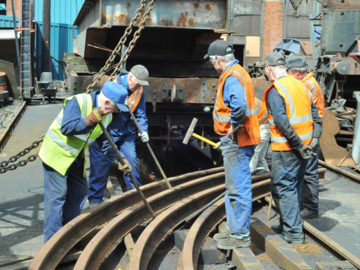5/5/2016: The Site gang chipping rust off the turntable carrying rails. (C.P. Friel)