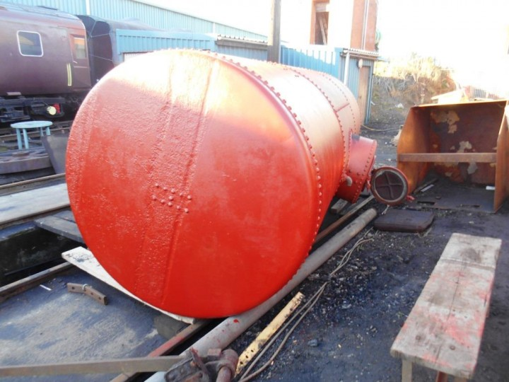 Under the gantries on 5th November 2016, HEI have shotblasted the tank and the site squad have painted it in red oxide primer. Once the tank gets undercoated and the wooden cradle re-made and fitted to the frames, the tank will be able to go back in again. (M.Walsh)