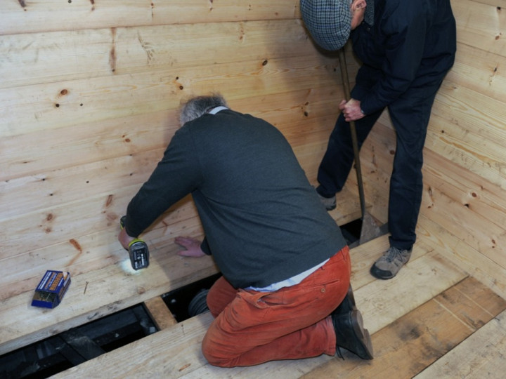 15/1/2020: Mark Kennedy and Richard Kenny attend to the final fitting of new floor timbers. (C.P. Friel)