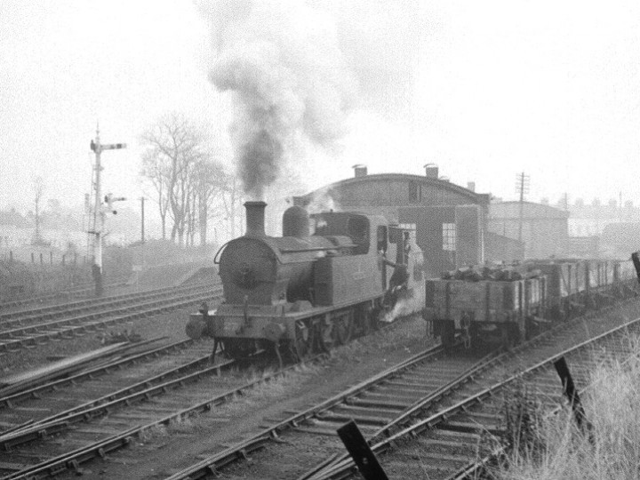 18/9/1967: No.27, still a UTA engine, is seen hauling the Guinness engine from Carrickfergus goods shed, where it had been stored, before working it to our base at Whitehead. The more economical Guinness engine has now taken the shunting and train rides roles previously filled by 'Lough Erne'. Later that year the engine was transferred to the new company Northern Ireland Railways. (J. Lockett)