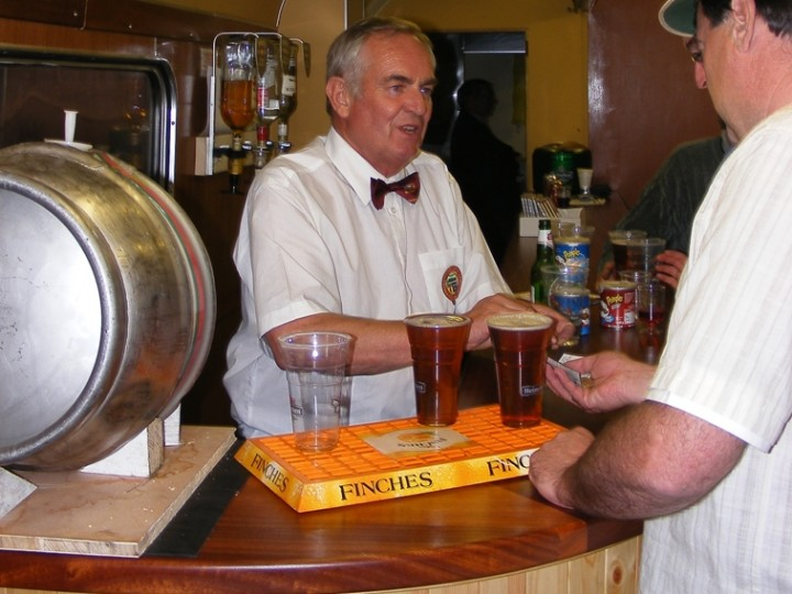 Peter Marsden serving passengers from behind the long bar on 547's first outing
