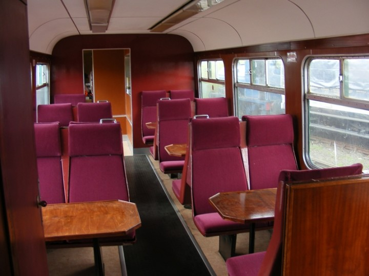 547's refurbished interior boasts varnished tables and maroon upholstered seating, before the curtains were hung