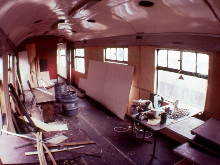 Rarely can a coach be purchased and put into traffic immediately. 87 had a leaking roof, a damp interior, rotten structural members and a host of other problems. Stripping and refurbishment of the interior can be seen in progress in this early 1980s view.