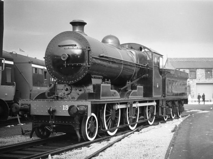 No.461 at an Inchicore open day in 1968. CIÉ staff have painted her up as DSER 15, in black with red lining. In DSER days she did not have the distinctive Inchicore style smokebox - and the white-wall tyres are a very un-Irish feature apparently added in a fit of creative passion. In the background is GNR(I) No.131. (C.P.Friel)