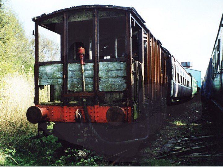 81 shortly after the fire, with the non-original vacuum brake equipment attached to the outside of the Larne-end veranda.